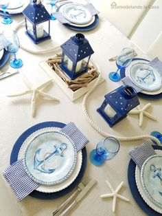 Blue Coastal Beach Summer Table Setting Ideas, Featured on Completely Coastal. Including an Out at Sea inspired Table Decor Idea with deep Blues and Anchor Lantern Motif.