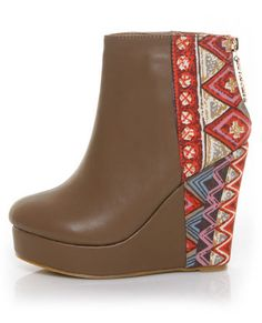 I found these on Lulus.com. If shoes could be compared to haircuts, these would be a mullet. They look like the average wedge ankle boots from the front, but the back is trendy tribal. I really like the large patterning of tribal clothing. Tribal patterned clothing is an easy way to keep trendy without constantly reaching for the LBD.