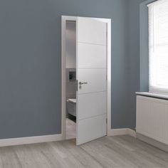 Explore the Internal White Primed Adelphi Door (LADE) from JB Kind at Leader Doors. Contemporary Doors, Contemporary Style, Interior Door Styles, Interior Doors, Tall Cabinet Storage, Locker Storage, White Internal Doors, Timber Door, Fire Doors