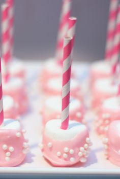 """Girly marshmallow pops: Add fun """"pearl"""" sprinkles to pink candy coating before it dries"""