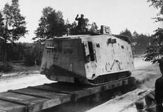 Western front, loading a German A7V tank onto a railroad flat car. Fewer than a hundred A7Vs were ever produced, the only tanks manufactured by Germany that they used in the war. German troops did manage to capture and make use of a number of allied tanks, however.