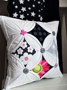I love cathedral window quilts.  This is such a fun pillow, and I like the added buttons