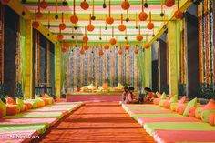 Bright colours and marigold balls for the Mehendi Decor! #IndianWedding #decor #inspiration | Curated by #WittyVows - The ultimate guide for the Indian Bride | www.wittyvows.com