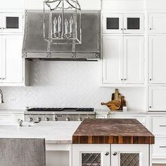 White Porcelain Herringbone Tile Backsplash