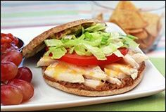 Chicken Torta  Ingredients:  One 100-calorie flat sandwich bun  1 tbsp. mashed avocado  3/4 tsp. taco seasoning mix  1 tbsp. salsa or pico de gallo  1/2 tbsp. diced onion  2 tbsp. fat-free refried beans  3 oz. cooked and sliced skinless chicken breast  1 tbsp. shredded Mexican-blend cheese  1 large tomato slice   1/3 cup shredded lettuce
