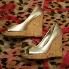 New without tags metallic leather wedge open toe Silver leather open toe wedge shoes. Very chic will perk up any outfit. There is a marking on the toe area of the right shoe as seen in second picture. This is not noticable when wearing. Michael  Shoes Wedges