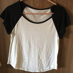 Black and white shirt sleeve top Only worn a few times - small barely noticeable stain below right shoulder. Other than that very good condition!! SO Tops Tees - Short Sleeve
