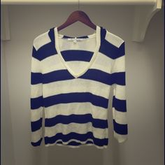 American Rag Striped Knit Sweater Super cute navy and white striped knit sweater from American Rag. V neckline and hooded. Barely ever worn. No stains or flaws of any kind. American Rag Sweaters
