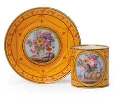 A SEVRES ORANGE-GROUND CUP AND SAUCER 1786