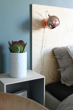 """This color (""""balanse"""" from Jotun) goes so well with the headboard in plywood."""