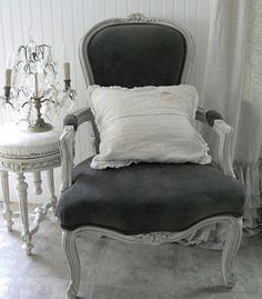 white interior, black chair. gray.