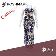 """🇺🇸BOGO 50% off🇺🇸 Beautiful floral design with shades of pink, tan, red on top of Navy blue background. Has double slits on each side. Features a peek-a-boo opening in back.   95% polyester 5% spandex   Stretches up to 3"""" more  ALL measurements taken laying flat. PLEASE SEE BELOW  Length: 58"""" all Sizes 1X Bust 17"""" Waist 15"""" Hips 18"""" 2X Bust 18"""" Waist 16"""" Hips 19"""" 3x Bust 19"""" Waist 17"""" Hips 20"""" Dresses Maxi"""