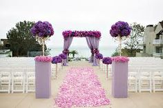 Add a splash of Pantone colour of the Year 2014 - Radiant Orchid to your beach wedding ceremony setting www.kerryjacksonrider.co.uk