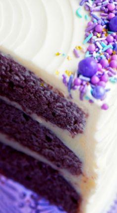 Purple Velvet Cake with Cream Cheese Frosting ~ Moist purple velvet cake filled and frosted with classic cream cheese frosting and topped with a medley of sprinkles.