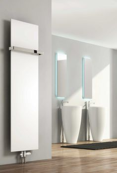 Reina Slimline Vertical Radiator. With a neat and comtemporary look, these will suit all interiors. Vertical and horizontal options available. Available in White, Anthracite & Silver from stock. Please note Chrome adjustable towel bars are optional and not included in the price. Complete with a 5 year guarantee. Prices from £111.54!