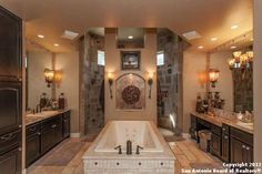 In LOVE with this Master Bathroom! A Dream Come True! Great Wrap around shower with his and her sinks.