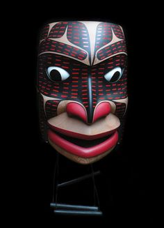 Corey W. Moraes is of Tsimshian heritage (Lax Kwa' Laams Band) and belongs to the Raven Clan ~ 'Someone Kept Saying Potlatch 1' ~ Red cedar, airbrush paint, lettering enamel, dowel, twine, tacks, copper. Fully articulated eyes and jaw. photo credit: John Calhoun ~ Tsimshian Fine Arts