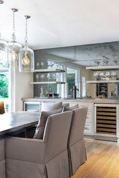 really like this bar - antiqued mirror, shelves, wine fridge, beverage center