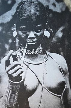 """This portrait depicts a Mon-Khmer woman, one of the descendants of the ancient people of Vietnam and Kampuchea (Cambodia). Black soldiers of the Vietnam War era brought back stories of the black people they saw in the mountains--""""Montagnard"""" means """"Mountain People""""--who fought alongside U.S. troops against North Vietnam. Ancient Chinese sources describe the wealthy Mon-Khmer who ruled the ancient kingdoms of Chamba (Fu-nan) and Khampa (Lin-Yi) as having """"curly hair and black skin."""""""