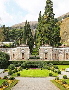 VILLA D'ESTE: The mosaic wall in the Renaissance garden, with a view toward the statue of Hercules, as seen outside the Veranda dining room.