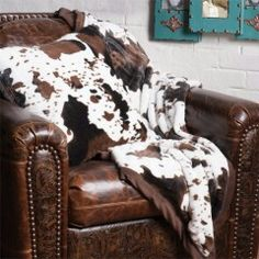 Cow print throw and pillow for the livingroom