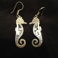 Sterling 925 seahorse earrings. Sterling silver 925 seahorse earrings from Mexico are hand-wrought and feature rich iridescent abalone inlays. Fish hook style for pierced ears.  Seahorse measures 1.5 inches in length. Jewelry Earrings