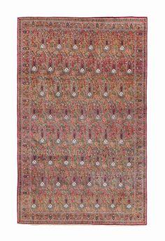 KIRMAN RUG  SOUTH EAST PERSIA, CIRCA 1890    7ft.5in. x 4ft.8in. (225cm. x 141cm.)