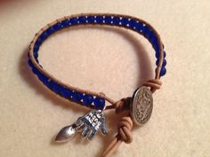 Leather wrap bracelet with charms.