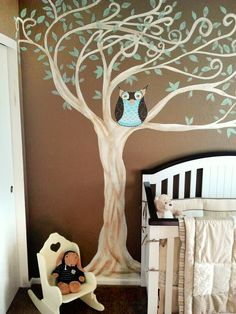 Gender neutral nursery theme. I hand painted the owl and the tree and found pieces that went well with the mural.