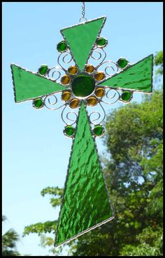 Angular pieces of stained glass, curved wire and glass nuggets make up this delightful sun catcher. It measures 8 x 12.  - www.AccentOnGlass.com