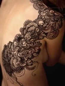 Not sure what pattern of lace I want my tattoo to be but I Am getting an idea...told Dustin to get to drawing! lol
