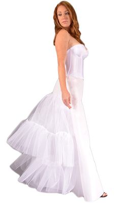 A special wedding dress slip with crinoline tulle forming a bustle for that perfect shape. - Crinoline - 2 layers with 2 tiers each formed in the back only. - Offered in White, Ivory, or Black Waistba
