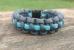 Grey with Turquoise Stripe Center ParaCord Bracelet by ParaWear550