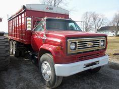Red Chevrolet C65 tandem grain truck