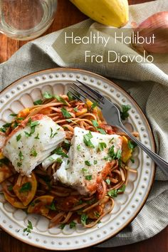 Healthy Halibut Fra Diavolo - this 21 Day Fix approved dinner recipe has a delicious, spicy sauce that's so, so easy to make! Plus since the fish cooks in the sauce, no extra pans to clean up!