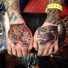 Beautiful tiger and panther hand tattoos