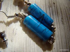 Medium Blue and Black Squiggly Lined Tube Earrings with Decorative Silver Tibetian Bead Earrings by KLKEndeavors on Etsy Voss Bottle, Water Bottle, Bangle Bracelets, Bangles, Little Bag, Turquoise Color, Wedding Sets, Bead Earrings, Tube