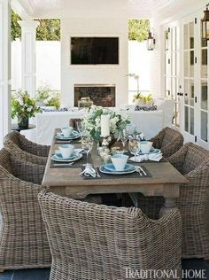 Whole house pictorial.Bill and Giuliana Rancic decorate their poolside patio dining area with classic blue and white tableware. Wicker Dining Chairs, Patio Dining, Dining Area, Dining Table, Patio Chairs, Dining Rooms, Dining Decor, Dining Sets, Office Chairs