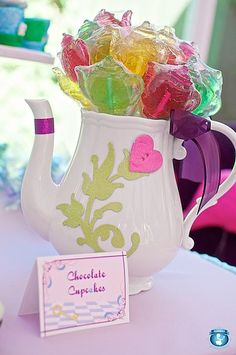 Alice in Wonderland Treats: An ordinary white teapot got an Alice in Wonderland upgrade with decorative scrapbook embellishments—and made the most perfect lollipop holder for these colorful teapot lollies!  Source: Sweets Indeed