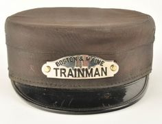 Trainman's railroad hat for the Boston & Maine Railroad with enameled hat badge. Manufacturer marked The Opper Cap Co Cleveland. size: unmarked