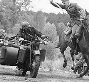 A Polish cavalry unit dares to attack a German motorcycle unit with only a sword. Since the end of the Great War, the Polish army was much less advanced than the German Army, often sending cavalry against German Panzer columns.