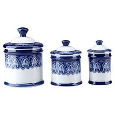"Three Art Deco-style porcelain canisters in hand-painted blue and white with classic ornamentation.   Product: Small, medium and large canisterConstruction Material: PorcelainColor: Blue and whiteFeatures: Hand-painted Dimensions: Small: 5.5"" H x 3"" DiameterMedium: 5.5"" H x 4.25"" DiameterLarge: 7"" H x 5"" Diameter  Cleaning and Care: Wipe with soft dust cloth"