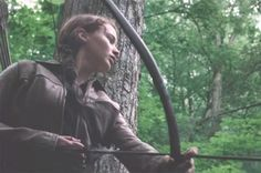 katniss everdeen from hunger games in tree
