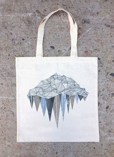 This cotton canvas tote bag features a hand drawn illustration of an iceberg…