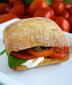 Tomato, mozzarella and pesto sandwich from @skiptomylou.org   Perfect sandwich for these hot summer days in Texas! And the colors are fabulous!