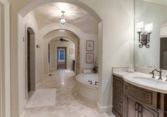 Separated Dressing areas and closets, with shared bath and shower...