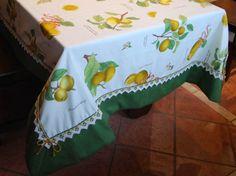 TOVAGLIA LE ZAGARE - PatriziaB.com Splendida tovaglia in tessuto di cotone in cui si dispiegano tralci di limoni, incorniciata da un bordo in tessuto verde menta e merletto