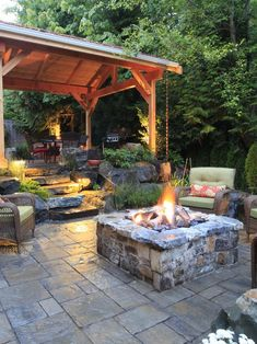 Rustic Patio with Pathway, Grand Manor Wicker Cushion Club Chair, Fire pit, exterior stone floors, Atlantic Blue Pavers