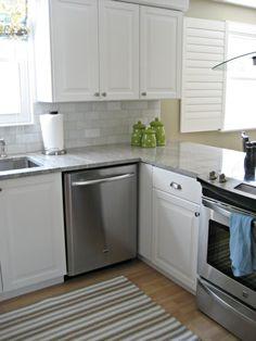 Terramoto green polka dot canisters, ikea kitchen, oak floors, light and airy