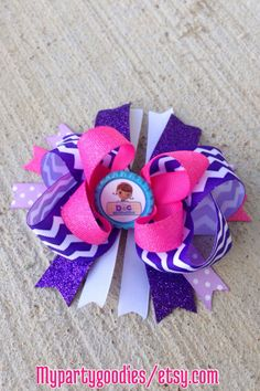 Doc Mcstuffins hair bow, hair accesories Doc Mcstuffins, hair bow toddlers. by Mypartygoodies on Etsy https://www.etsy.com/listing/209461315/doc-mcstuffins-hair-bow-hair-accesories